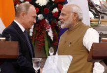 Prime Minister Narendra Modi and Russian President Vladimir (L)