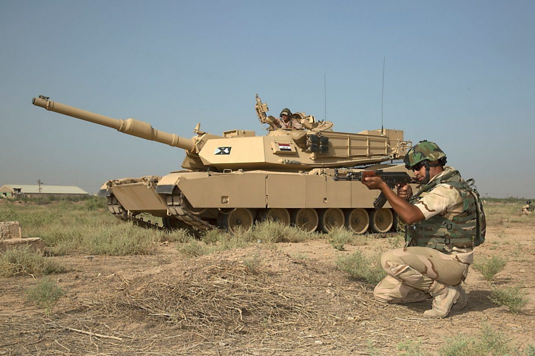 An Iraqi soldier pulls security while awaiting further orders as part of a combined training event at Camp Taji, Iraq
