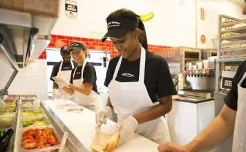 Jimmy John employees having fun making sandwiches