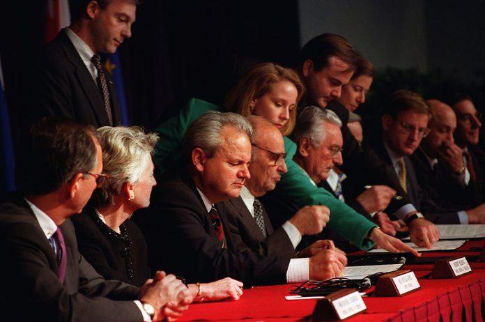 President Slobodan Milosevic of Serbia (third from left), President Alija Izetbegovic of Bosnia-Herzegovina (fourth from left) and President Franjo Tudjman (sixth from left) of Croatia sign the Dayton Accords, 21 November 1995